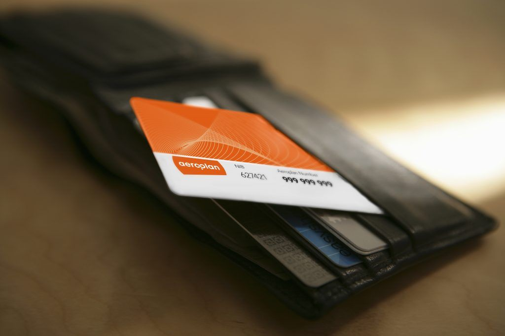 Wallet with an Aeroplan card