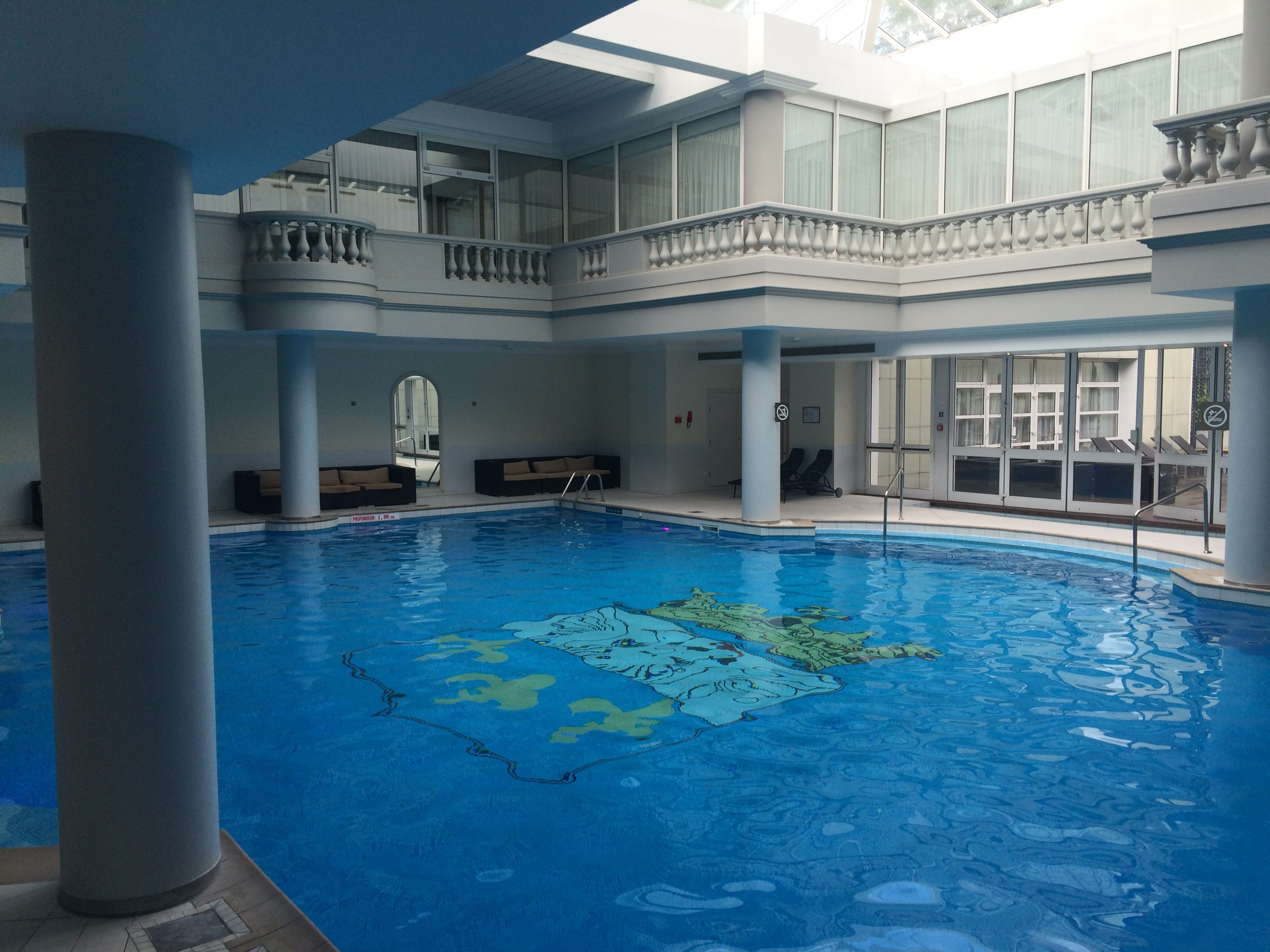 Grecian-style indoor pool at Trianon Palace, A Waldorf Astoria Hotel.