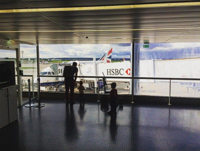 Family boarding a British Airways flight in Orly