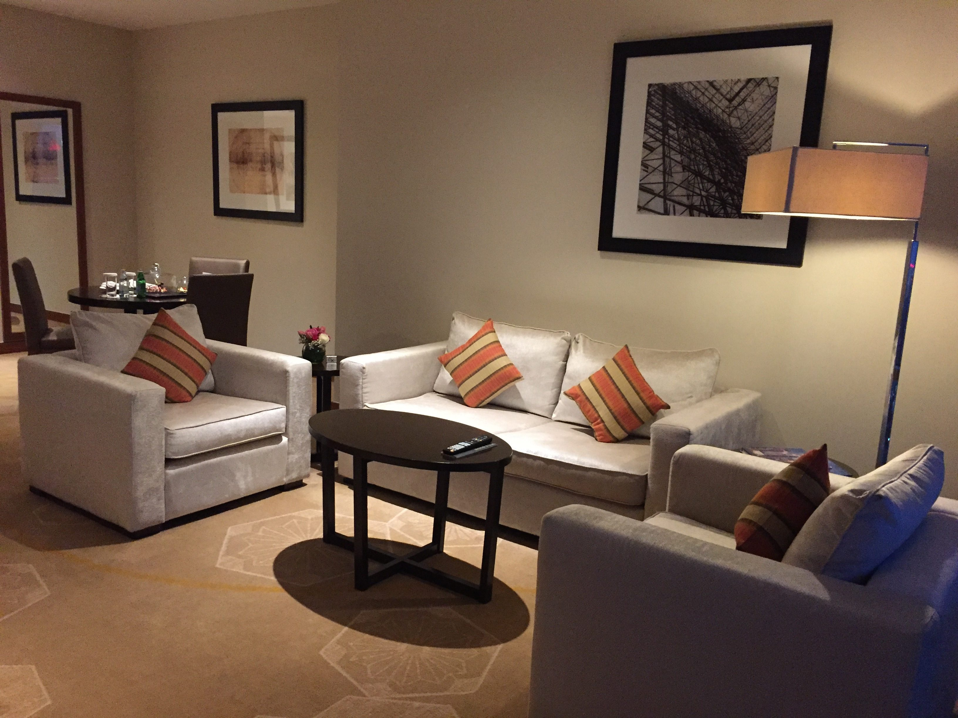 Huge living room can features 3 sofas and can fit 5 adults- InterContinental Doha The City