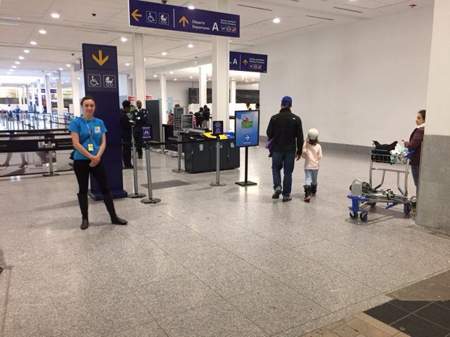 Volunteers showing the way to families heading to security checks