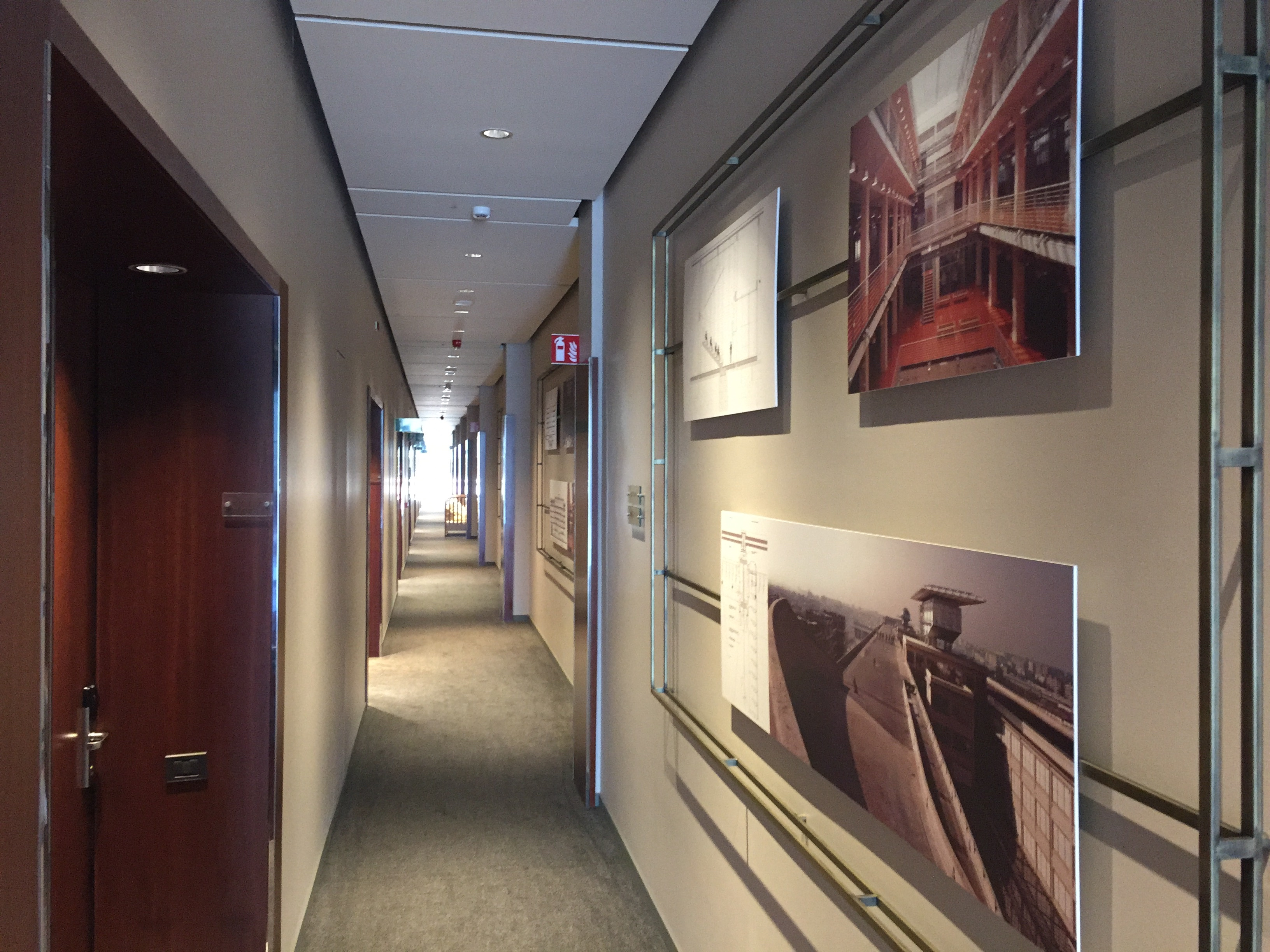 DoubleTree Turin Lingotto hallway that features photos of the former Fiat factory.