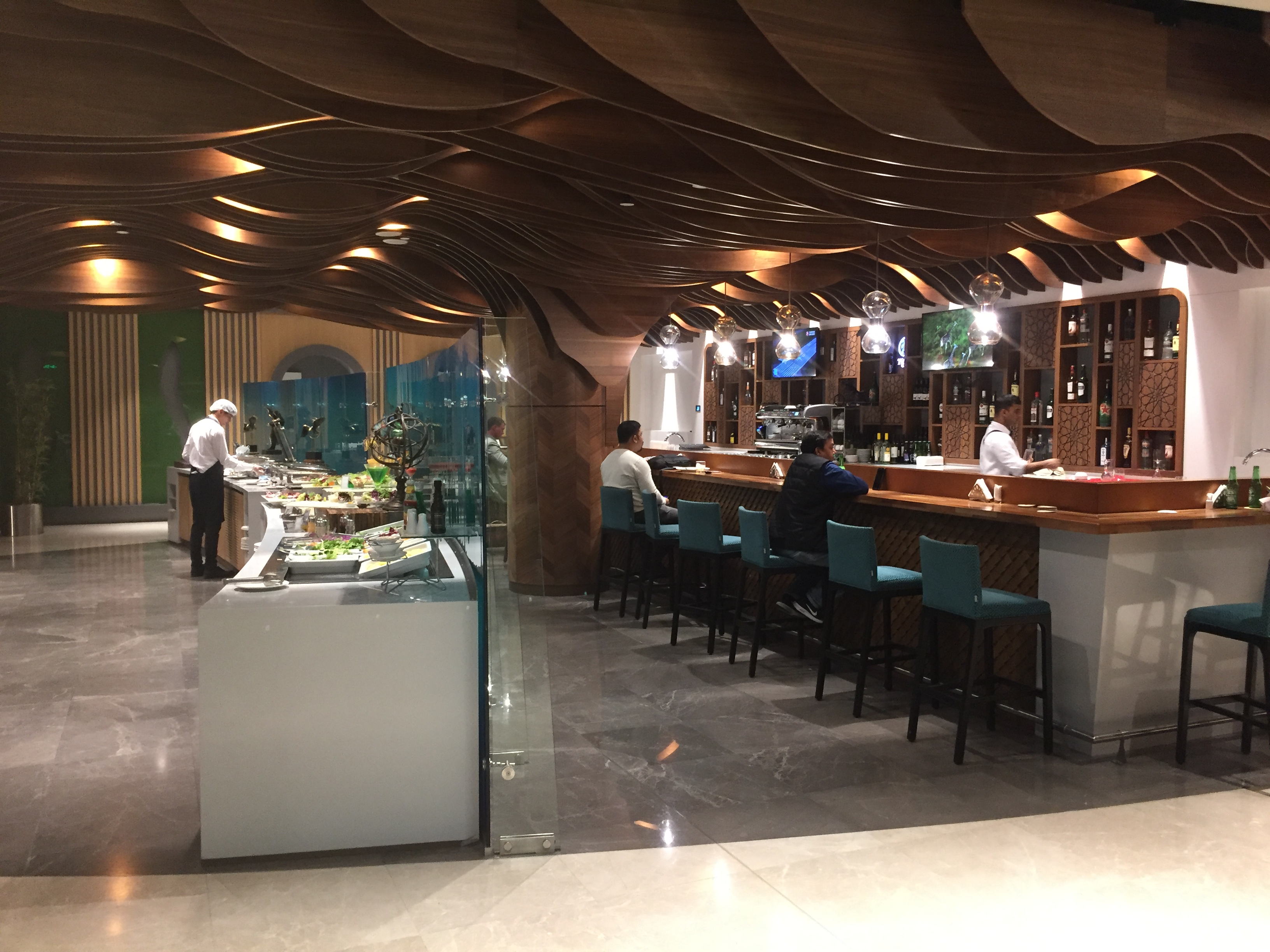 Buffet & bar area | The Primeclass Lounge Muscat