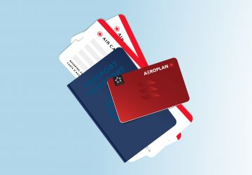 Aeroplan card with passport and boarding pass